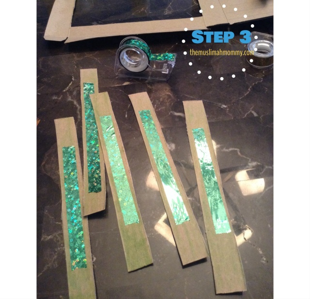Use a cardboard box (or cereal box) to cut out strips to use as the stems. You can colour the stems green using markers, crayons, etc. We also used some shiny tape on the stems for some sparkle!